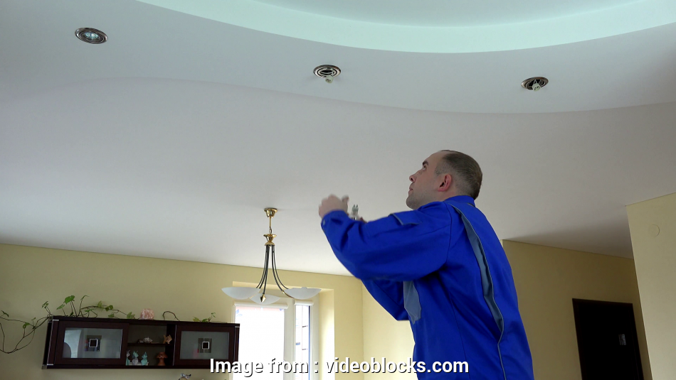 how to install ceiling halogen lights Skilled electrician, install or replace halogen spot light lamp into ceiling Stock Video Footage, Videoblocks 19 Perfect How To Install Ceiling Halogen Lights Ideas