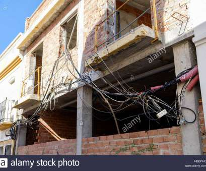 1949 home electrical wiring unsafe electrical wiring tangled up outside a house under development, Stock Image 1949 Home Electrical Wiring Top Unsafe Electrical Wiring Tangled Up Outside A House Under Development, Stock Image Pictures