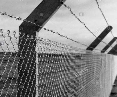 concrete wire mesh fence Barbed wire topped concrete & wire mesh fence in black, white Concrete Wire Mesh Fence Fantastic Barbed Wire Topped Concrete & Wire Mesh Fence In Black, White Images