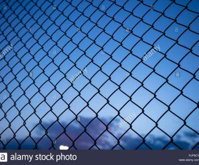 http://wire_mesh_fence.zip Dark blue, through wire mesh fence. Blur background, close up view of link cage, wallpaper Popular Dark Blue, Through Wire Mesh Fence. Blur Background, Close Up View Of Link Cage, Wallpaper Ideas