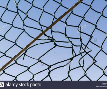 diamond mesh wire fence Torn hole in a wire mesh, hurricane, or cyclone steel fence, Stock Image Diamond Mesh Wire Fence Professional Torn Hole In A Wire Mesh, Hurricane, Or Cyclone Steel Fence, Stock Image Galleries