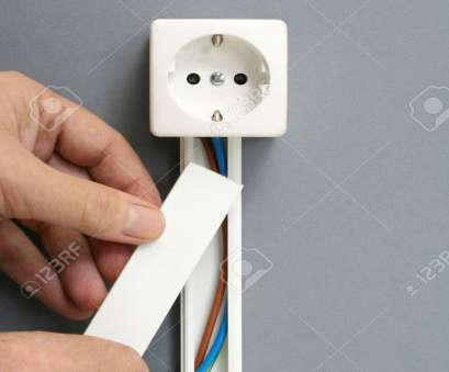 electrical outlet plug wiring Installing a power outlet with surface mount electric wiring channel Stock Photo, 59744350 Electrical Outlet Plug Wiring Most Installing A Power Outlet With Surface Mount Electric Wiring Channel Stock Photo, 59744350 Images