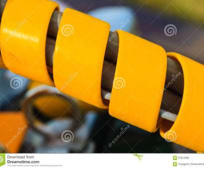 electrical wires cover Machines, production concept. Electrical tube wires in orange rubber protective cover casing Electrical Wires Cover New Machines, Production Concept. Electrical Tube Wires In Orange Rubber Protective Cover Casing Photos