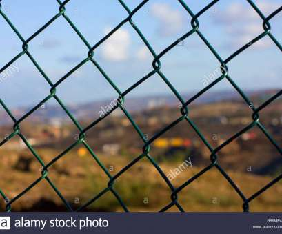 green pvc coated wire mesh fencing Green plastic coated security mesh fencing close up with blurred, of focus landscape behind of pathhead landfill site blaydon Green, Coated Wire Mesh Fencing Perfect Green Plastic Coated Security Mesh Fencing Close Up With Blurred, Of Focus Landscape Behind Of Pathhead Landfill Site Blaydon Pictures