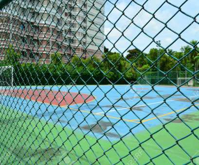 green wire mesh fence Stock Photo, Wire mesh fence with football field background Green Wire Mesh Fence Professional Stock Photo, Wire Mesh Fence With Football Field Background Solutions
