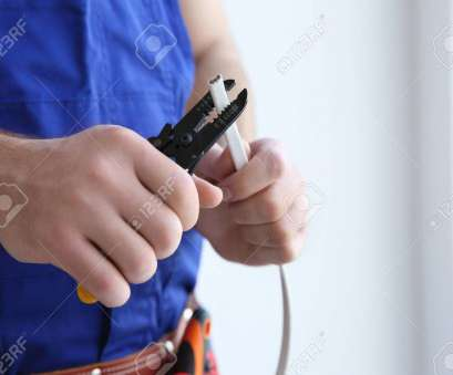 how to wire a light room Stock Photo, Young electrician skinning a wire in light room How To Wire A Light Room Brilliant Stock Photo, Young Electrician Skinning A Wire In Light Room Solutions