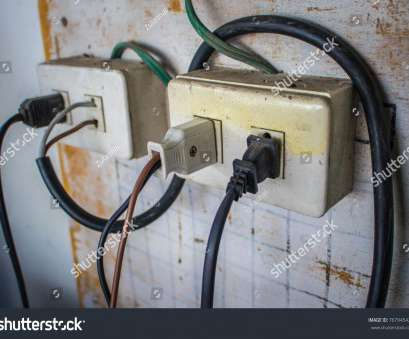 how to wire an electrical plug Old socket plug with electric plug line, bare wire on wood wall How To Wire An Electrical Plug New Old Socket Plug With Electric Plug Line, Bare Wire On Wood Wall Collections