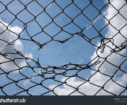 hurricane wire mesh fence Challenge / uncertainty / breakthrough concept / metaphor. Chain-link, wire netting, wire-mesh, cyclone hurricane fence. Happy, sad, Stock Photo Hurricane Wire Mesh Fence Nice Challenge / Uncertainty / Breakthrough Concept / Metaphor. Chain-Link, Wire Netting, Wire-Mesh, Cyclone Hurricane Fence. Happy, Sad, Stock Photo Photos
