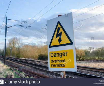live electrical wire danger Danger overhead live wires sign next to train tracks Stock Photo Live Electrical Wire Danger Perfect Danger Overhead Live Wires Sign Next To Train Tracks Stock Photo Solutions