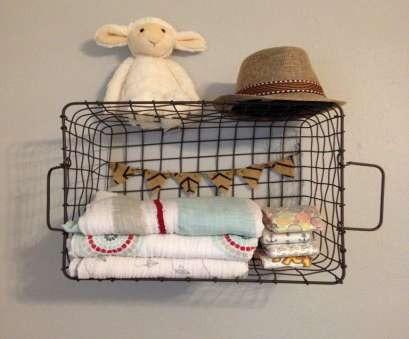 wire basket nursery storage Cute nursery storage idea: hang a wire basket on, wall to hold diapers, blankets, etc! #nursery #storage #organization 17 Creative Wire Basket Nursery Storage Solutions