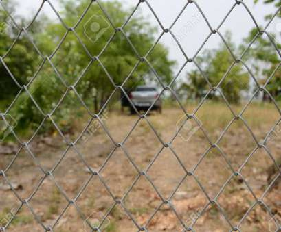 wire mesh fence thailand Stock Photo, Wire mesh fence with blur farm background in, countryside of Thailand Wire Mesh Fence Thailand Simple Stock Photo, Wire Mesh Fence With Blur Farm Background In, Countryside Of Thailand Collections