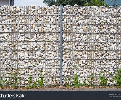 Wire Mesh Fence With Stones Top Gabion Fence Wall From Steel Mesh With Stones On German Street. Gabion Wire Mesh Fencing Solutions