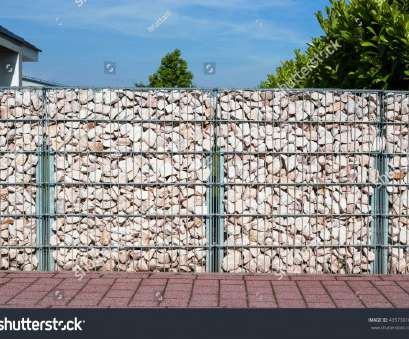 Wire Mesh Fence With Stones Practical Gabion Fence Wall From Steel Mesh With Stones On German Street.Gabion Wire Mesh Fencing Collections