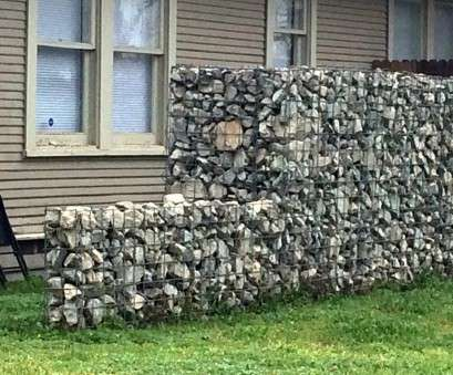 Wire Mesh Fence With Stones Simple Looks Like Someone Used Wire Mesh,, Type Used In Concrete Foundations... Built A Frame,, Filled It With Stones Ideas
