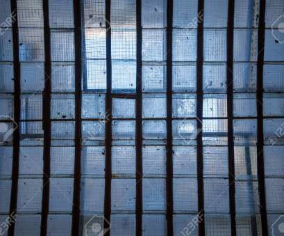 wire mesh glass Industrial ceiling skylight of wire mesh reinforced glass panes, supporting grid beams with gentle sunlight Wire Mesh Glass Simple Industrial Ceiling Skylight Of Wire Mesh Reinforced Glass Panes, Supporting Grid Beams With Gentle Sunlight Solutions
