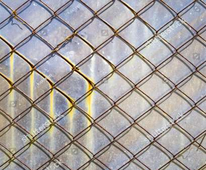 woven wire mesh sheet Rusty metal mesh against, background of a sheet of aluminum with rust stains. Metal Woven Wire Mesh Sheet Top Rusty Metal Mesh Against, Background Of A Sheet Of Aluminum With Rust Stains. Metal Photos