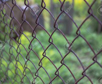 fence with wire mesh Old steel wire mesh fence with blurred background close, Stock Photo, 105040187 Fence With Wire Mesh Practical Old Steel Wire Mesh Fence With Blurred Background Close, Stock Photo, 105040187 Solutions