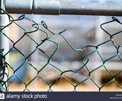 hurricane wire mesh fence Torn hole in a wire mesh, hurricane, or cyclone steel fence Stock Hurricane Wire Mesh Fence Brilliant Torn Hole In A Wire Mesh, Hurricane, Or Cyclone Steel Fence Stock Photos