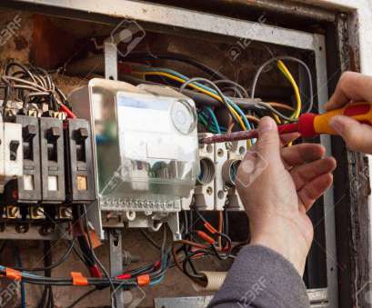 switchgear wiring Repair of, electrical switchgear. An electrician replaces, electrical wiring devices Stock Photo Switchgear Wiring New Repair Of, Electrical Switchgear. An Electrician Replaces, Electrical Wiring Devices Stock Photo Photos
