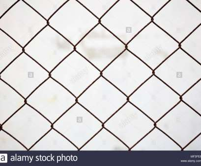 http://wire_mesh_fence.zip Wire mesh fence made of steel with white blurred background. Close up view with details Top Wire Mesh Fence Made Of Steel With White Blurred Background. Close Up View With Details Galleries